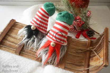 close up of Christmas gnome tutorial made into two naught and nice sock gnomes