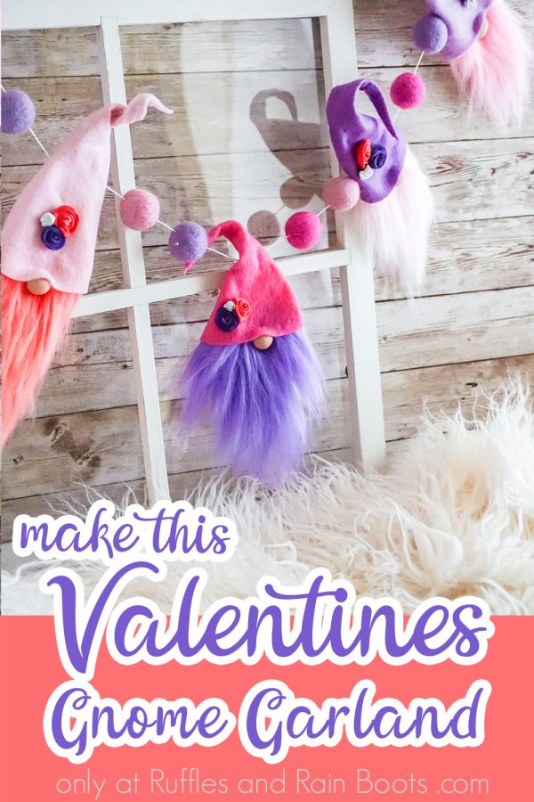 pink purple gnome garland with wool balls in bright color dyed fur with text which reads make this Valentines gnome Garland