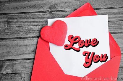 close up of Valentine's Day card with free love you SVG for a retro bump out design