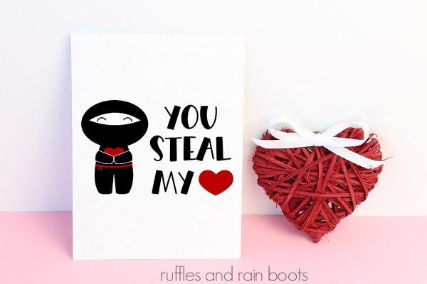 ninja svg on Valentine themed background with red string heart