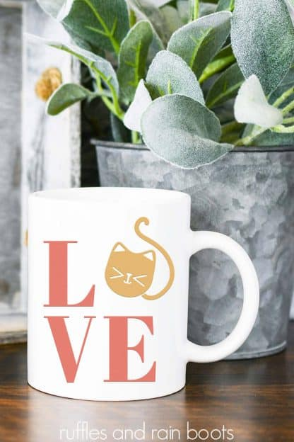 white mug with coral and tan cat LOVE SVG in vinyl for Cricut and Silhouette machines