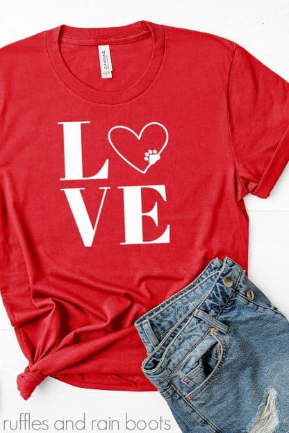 red t shirt on white background with jeans and a paw print LOVE animal SVG in white vinyl