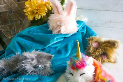 Pom Pom Pets on a table with blue linen