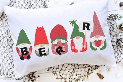 sublimation strawberry gnome designs on a pillow laying on a table