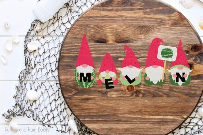 Watermelon Gnome cricut designs for crafting on a wood round sign laying on a table