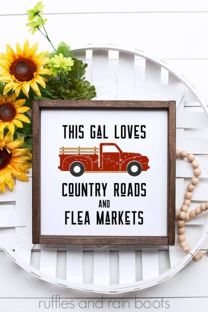 red distressed vintage truck SVG on white wood frame in cigar basket with sunflowers and farmhouse beads