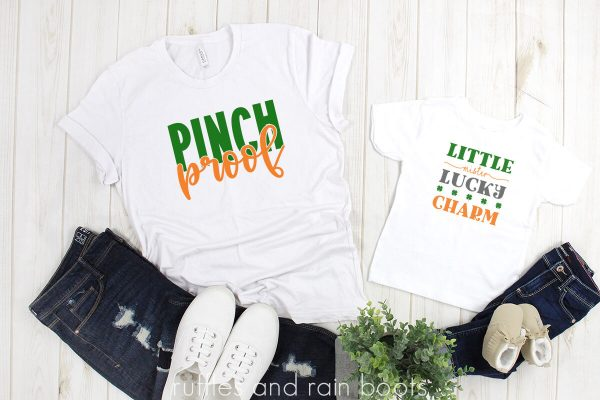 photo of two white shirts with pinch proof svg and little mister lucky charm cut files in orange green and gray on white background with jeans and shoes