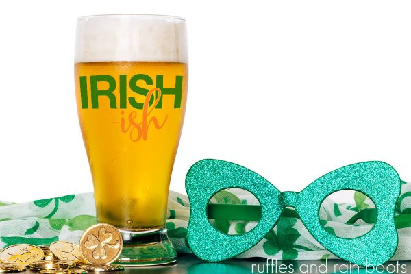 beer in glass with Irish-ish cut file and St Patricks Day decorations on wood table
