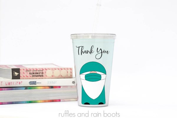 doctor nurse medical gnome cut file on light green tumbler with book stack on white background