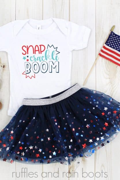 red teal white and blue snap crackle boom svg on white onesie with blue tulle skirt and american flag