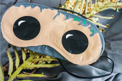 Baby Groot eye Mask SVG for cutting machines laying on a table with floral greenery