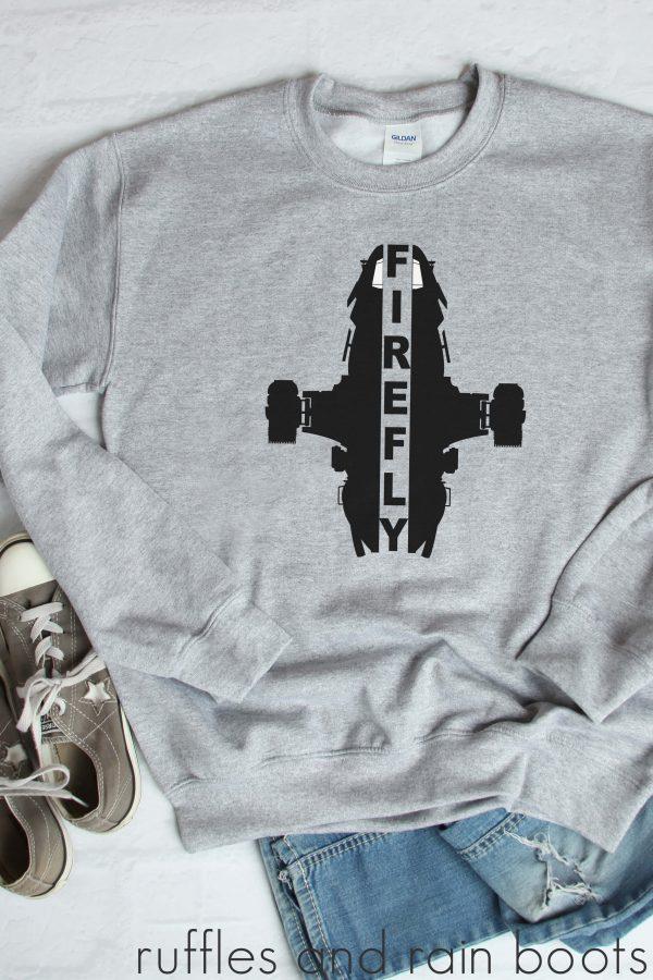 black vinyl Cricut project using firefly svg of serenity ship on gray sweathshirt