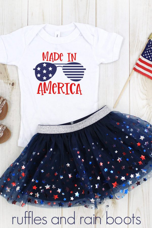 adorable July 4th Cricut Idea using free Independence Day SVG on white t shirt with flag background