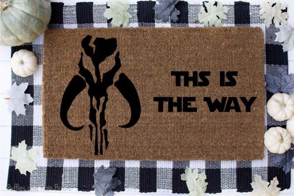 mandalorian skull svg set on a welcome mat