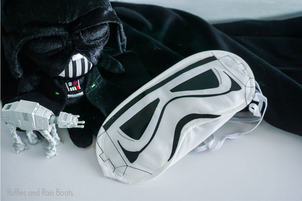 Stormtrooper eye mask on a table with star wars toys