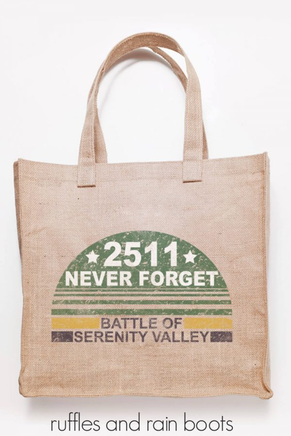 jute tote bag in natural color on white background with distressed svg file never forget battle of serenity added in vinyl using Cricut machine
