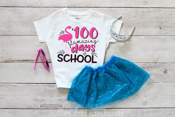 kids shirt laying on a table featuring a 100 days of school idea flamingo flamazing days of school svg