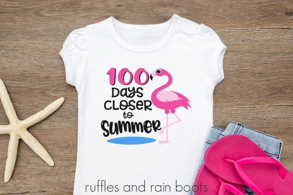 kids shirt on a table featuring a adorable 100 days closer to summer flamingo svg cut file set
