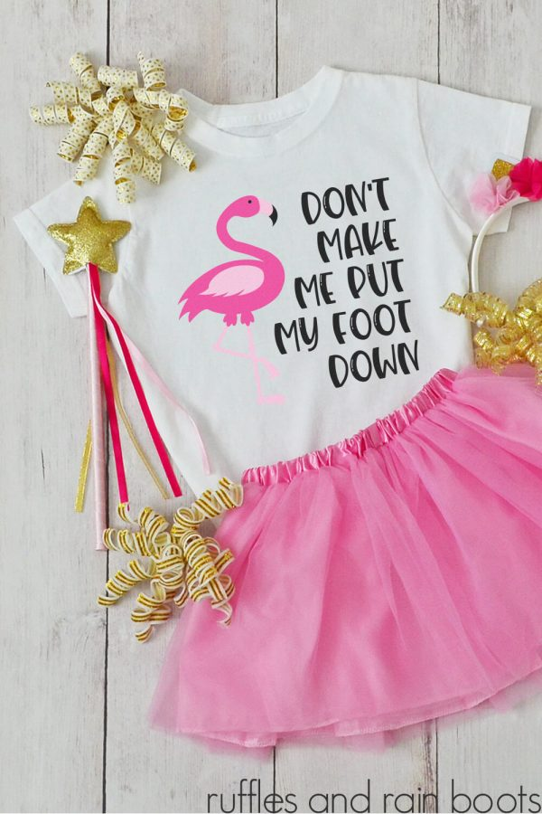 flamingo cut file for cricut that says don't make me put my foot down on a kids shirt with tutu and accessories laying on a table