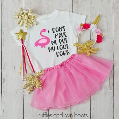 flamingo svg put my foot down on a kids shirt with tutu and accessories laying on a table