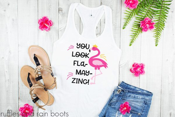 tank top layingon a wood table featuring a you look flamazing flamingo cut file for cricut