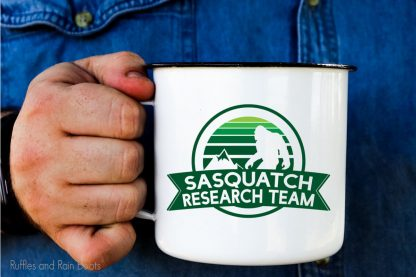 Sasquatch SVG for sublimation or infusible ink on a camp mug held by a hand