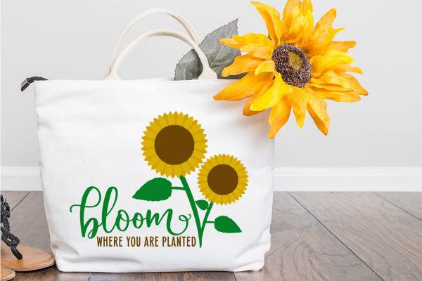 canvas bag sitting on the floor featuring the Sunflower SVG Files for farmhouse crafts for summer
