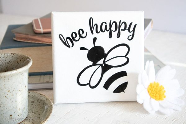 bee mini-canvas art piece on a table featuring a bee cut file made with cricut joy
