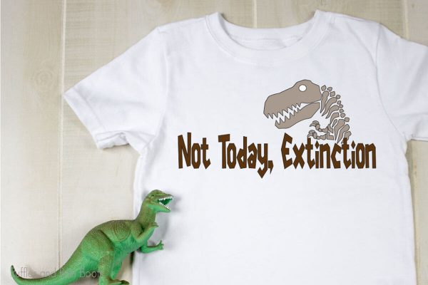 NOT TODAY EXTINCTION SVG for cutting machines on a t-shirt with a toy dinosaur on a table