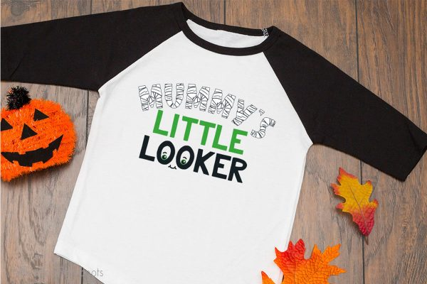 Mummy's LIttle Looker SVG for cutting machines on a raglan t-shirt for kids on a table
