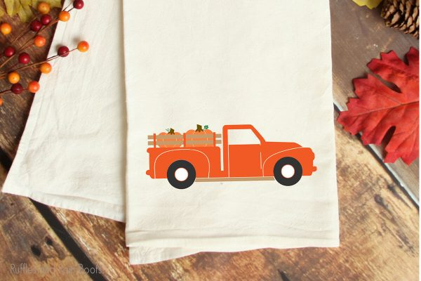 fall farm truck SVG cut file for cricut or silhouette on a kitchen towel on a table
