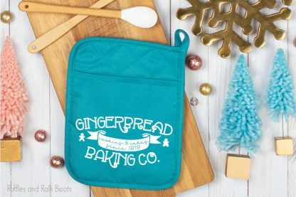 gingerbread baking co SVG cut file set for cricut or silhouette on a heat pad on a table with christmas decor