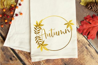 fall sublimation file with foil design on a kitchen towel laying on a table