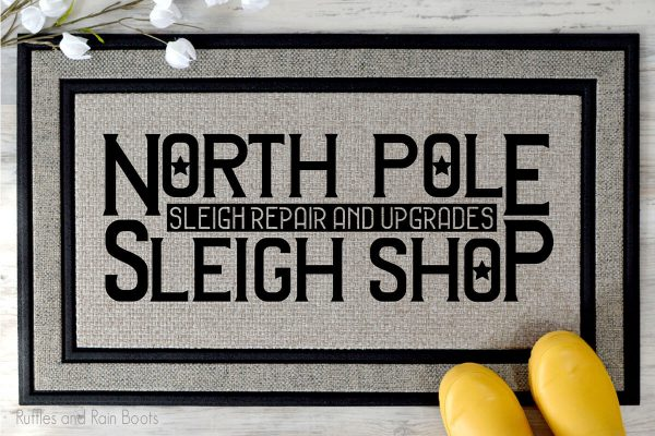 north pole sleigh shop SVG file set on a welcome mat