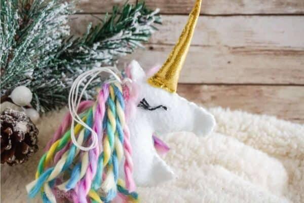 DIY unicorn christmas ornament SVG cut file set on a winter background