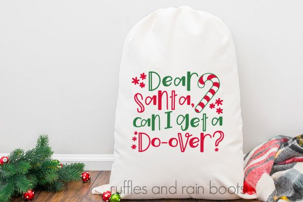 horizontal image of Dear Santa cut file for Cricut and Silhouette featured on a white gift bag