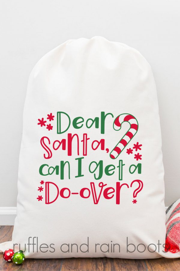 white Santa sack on hardwood floor with red white and green Dear Santa Can I get a do-over SVG for Christmas