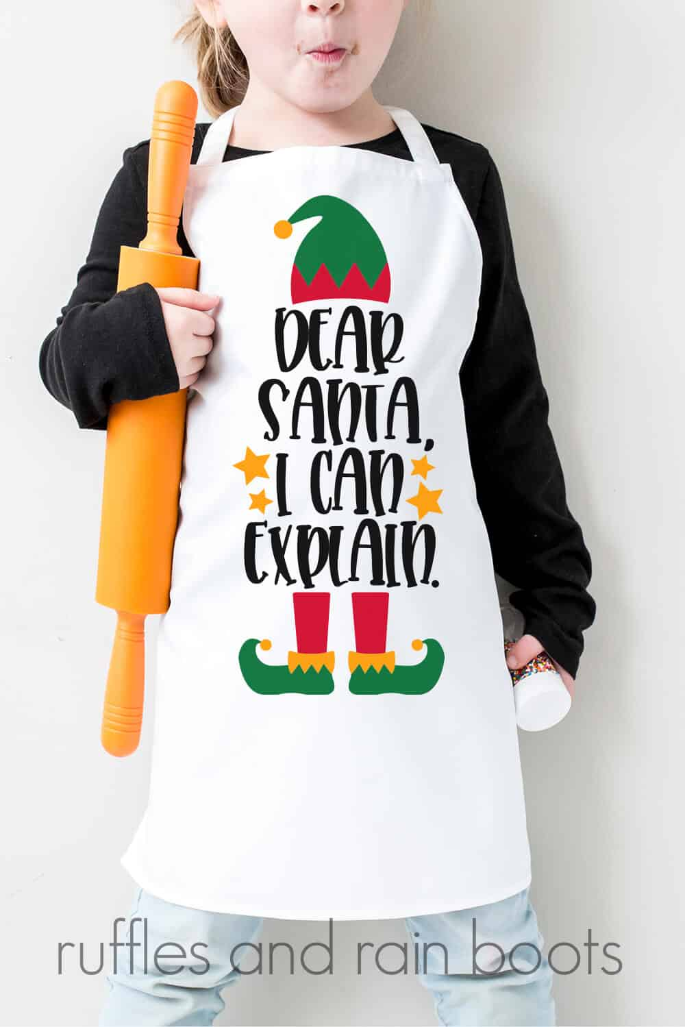 vertical image of child with white apron holding a rolling pin and a large colorful elf SVG with dear santa