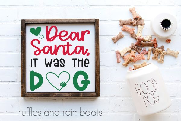 horizontal image featuring dog treats and a white frame on white background with a Christmas svg of Dear Santa it was the dog in red green and black