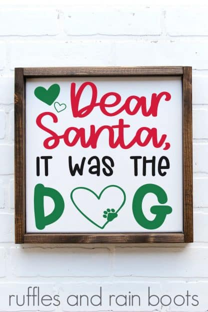 vertical image of white frame on brick background with red green and black design which says Dear Santa It was the dog