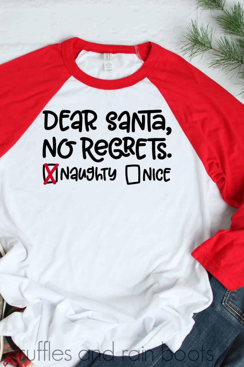 vertical image of red and white raglan t shirt Dear Santa No regrets design in black