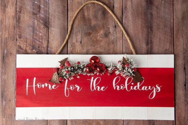 Home for the Holidays cut file set on a wood sign