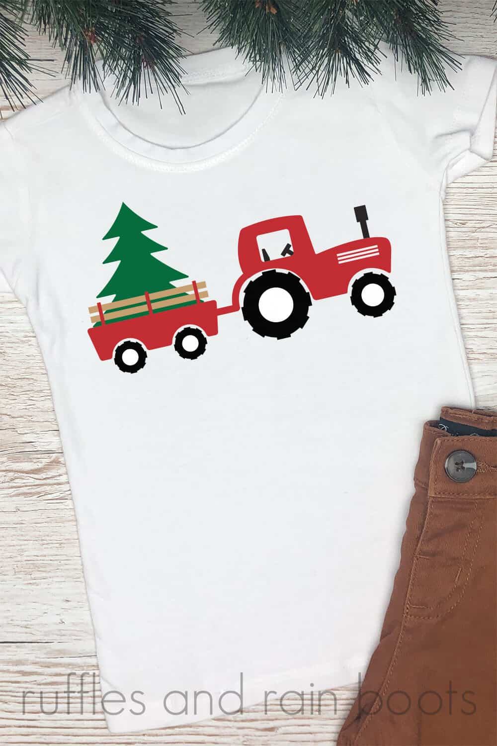 white t shirt with pine needles and brown pants on wood background with red green and black Christmas tractor svg