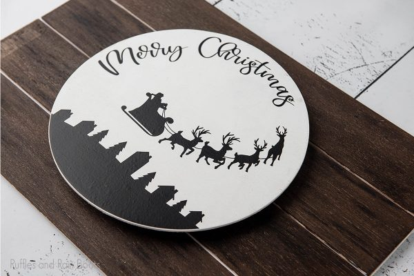 Merry Christmas cut file set on a wood round craft project