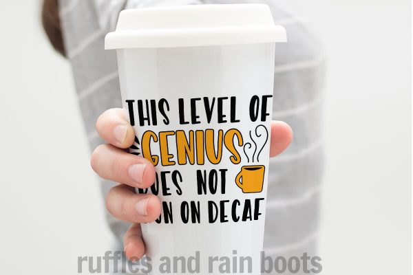 woman in gray shirt holding white coffee tumbler with orange and black words reading genius does not run on decaf made with vinyl