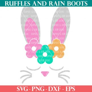 close up of gray pink green and orange sleepy bunny face svg