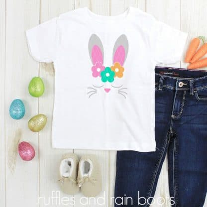 square image of Easter svg on white shirt featuring bunny ears flowers and sleeping face