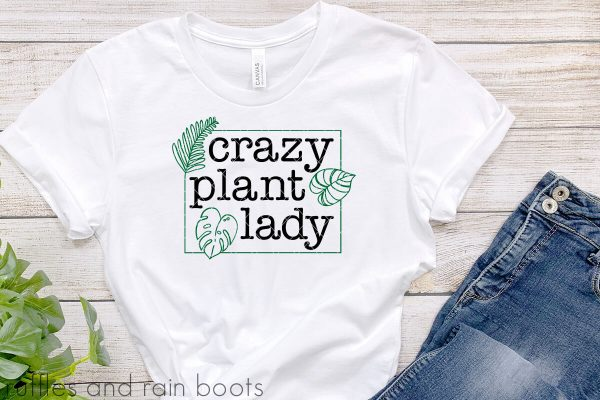 horizontal image of white t shirt and crazy plant lady cut file in black and green