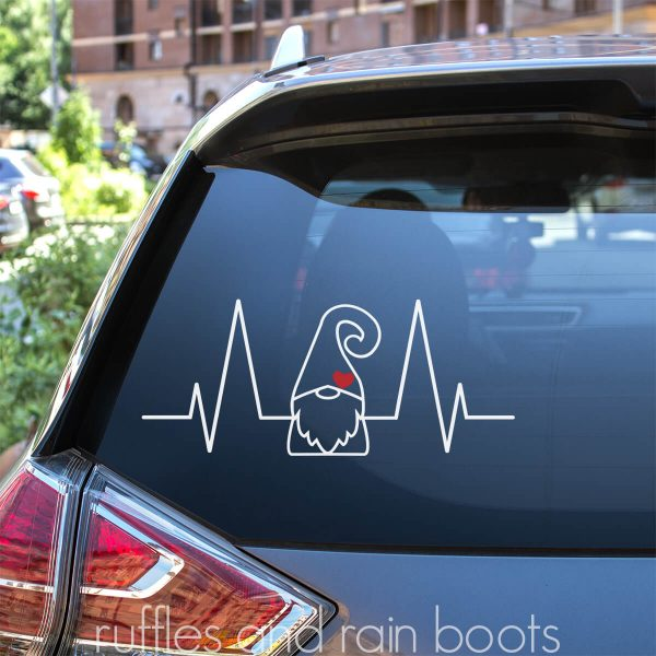 close up of car back window with gnome heartbeat svg decal in white and red