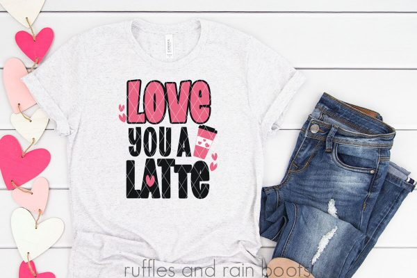 jeans and white t shirt on white wood background with love you a latte svg and hearts